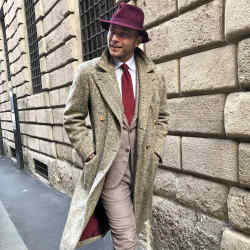 Luca Rubinacci wearing a Rubinacci vintage tweed Ulster overcoat, £5,200