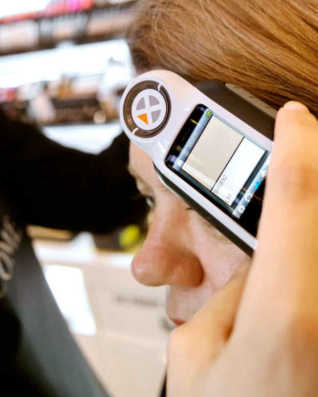 A hand-held device scans the face to assess the exact colour and tone of the skin