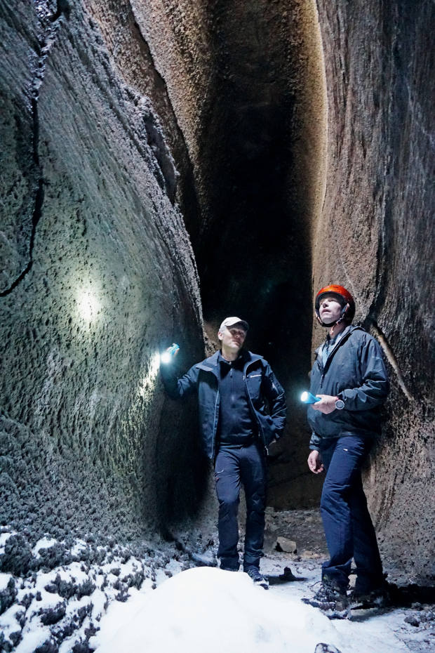 Exploring a lava cave with guide Lorenzo Motta
