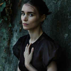 Rooney Mara wears Hiraeth lace-trimmed organza Ida dress, $1,300, from Dover Street Market (DSM) London, New York, LA and Singapore, and hiraethcollective.com
