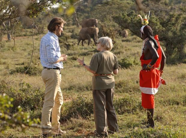 Dr Max Graham, Lucia van der Post and ranger Korosian Mpetela observe wild elephants