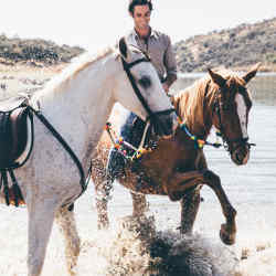 George Scott lets the horses cool off in a lake