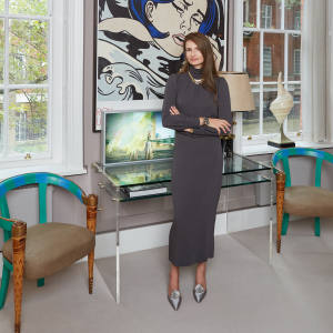 Alessandra Rich at home in London with a Roy Lichtenstein poster in the background