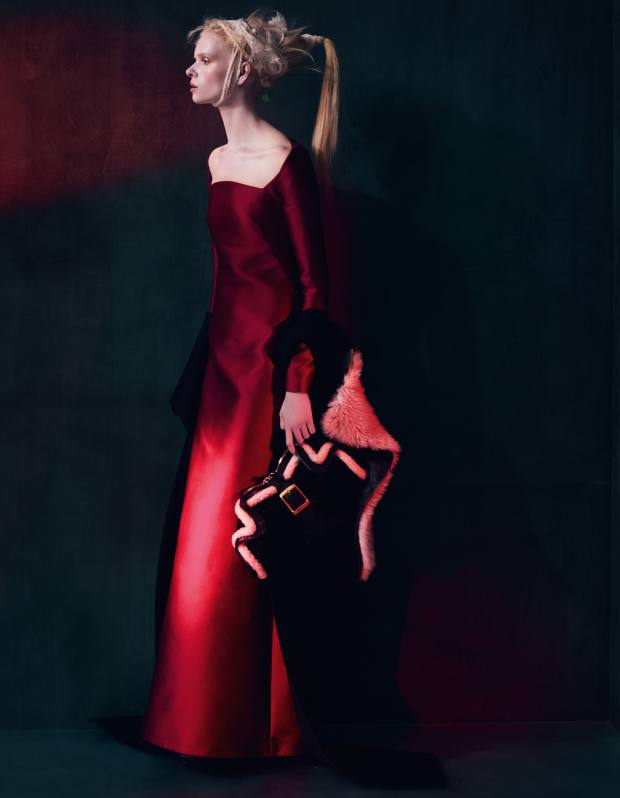 Silk dress, £2,535, by Valentino. Wool/shearling coat, £2,261, by Rick Owens. Baby nubuck/leather clutch, £695, by Alexander McQueen