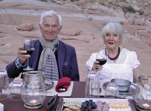 The author and her husband, Neil Crichton-Miller, dining on a rocky hillside overlooking Lake Powell, Utah
