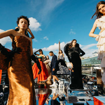 Balmain creative director Olivier Rousteing among models atop a boat on the Seine