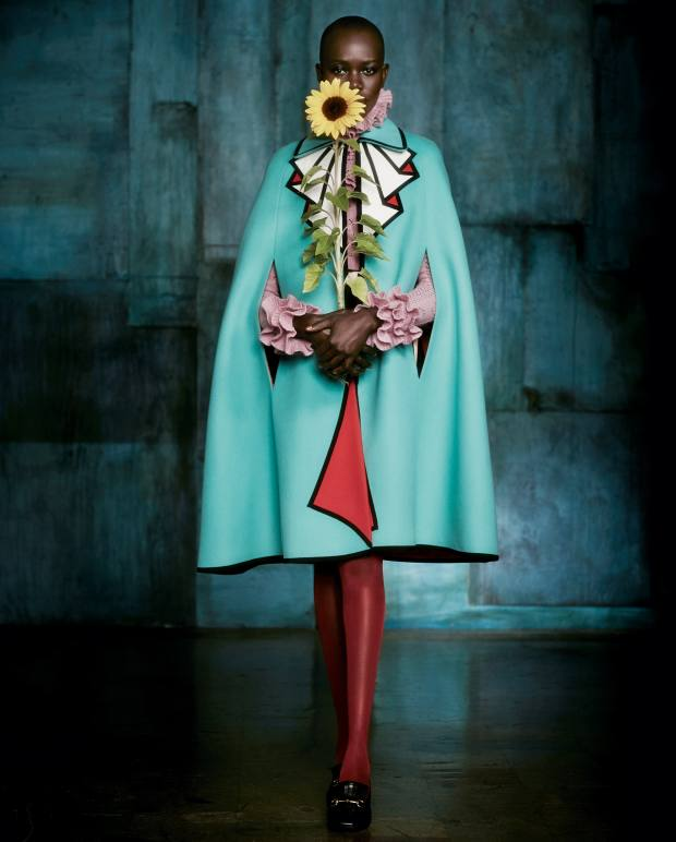 Gucci wool and grosgrain ribbon cape, £1,850, merino wool top, £725, nylon tights, £40, and leather moccasins, £515