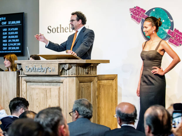 David Bennett, Sotheby's worldwide chairman of jewellery, fielding bids atthe auctionhouse's Magnificent and Noble Jewels sale in Geneva inMay2017