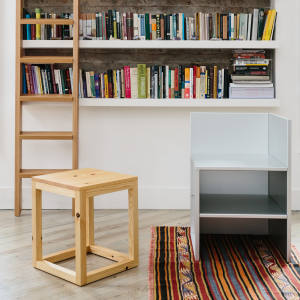 Donald Judd Pine Library Stool 42, $1,900, and anodised aluminium Corner Chair 15, $6,900