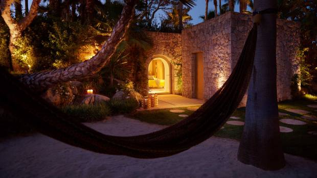 At sunset the mood changes and the villa with its tropical garden becomes the setting for a dinner created by Spanish chef Quique Dacosta