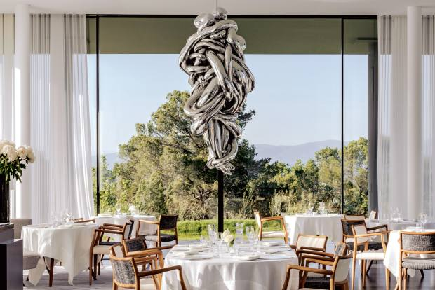 The restaurant at Villa La Coste in the south of France, with a sculpture by Louise Bourgeois