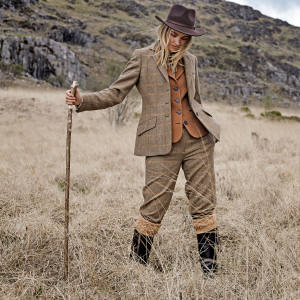 Really Wild tweed Ledbury jacket, £285, tweed and leather Dewsbury waistcoat, £195, tweed breeks, £195, La Mancha leather boots, £345, and felt Outback hat, £75