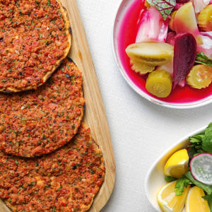 At 29, in the Ulus area of Istanbul, lahmacun is served with rocket, radish and lemon
