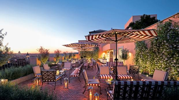 Hotel de la Ville's rooftop bar at sunset, with its panoramic views of Rome