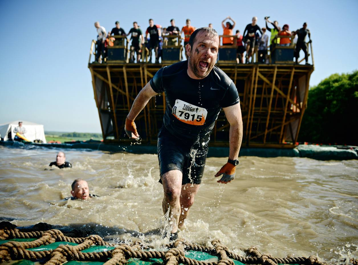 Participants emerging from the Walk the Plank obstacle, London South 2013
