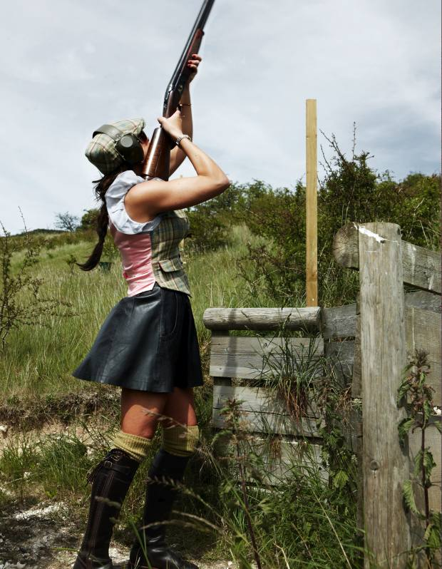 Claire Poole, in her eye-catching shooting attire, with her vintage 12-bore Holland & Holland over-and-under.