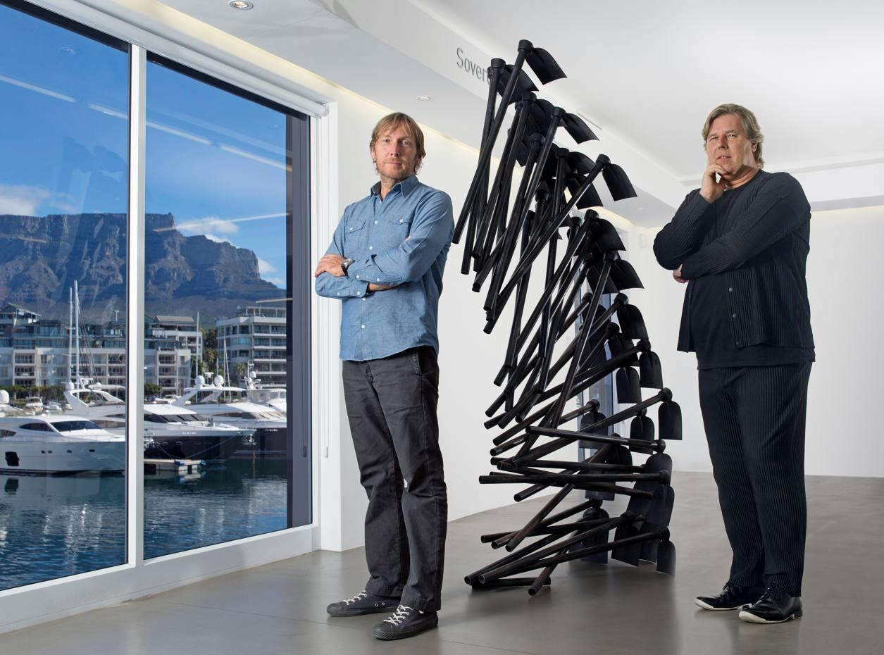 Jochen Zeitz (left) and Mark Coetzee at the Zeitz Mocaa Pavilion, Cape Town, with Ikhuba from Michele Mathison's Harvest installation