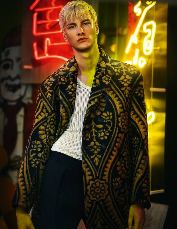 Burberry Prorsum wool/silk coat, £4,995, cashmere fisherman vest, £195, and wool/cashmere trousers, £495 Neon signs from the film Tomb Raider, both price on request, from God's Own Junk Yard