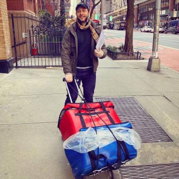 Citymeals on Wheels board member Derek Blasberg delivering emergency meals to his elderly neighbours in Manhattan