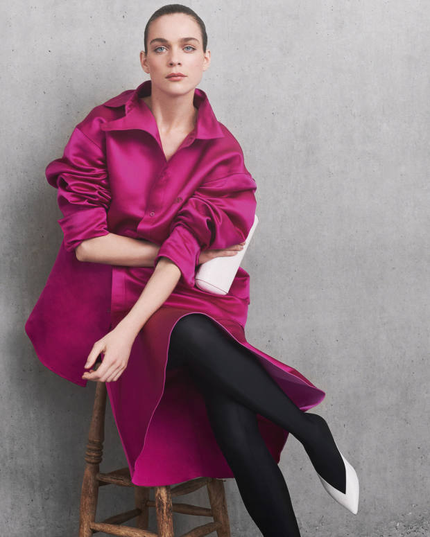 Balenciaga silk satin shirt, £1,450, matching skirt, £1,753, and leather clutch, £865. Givenchy leather andLycra boots, €995