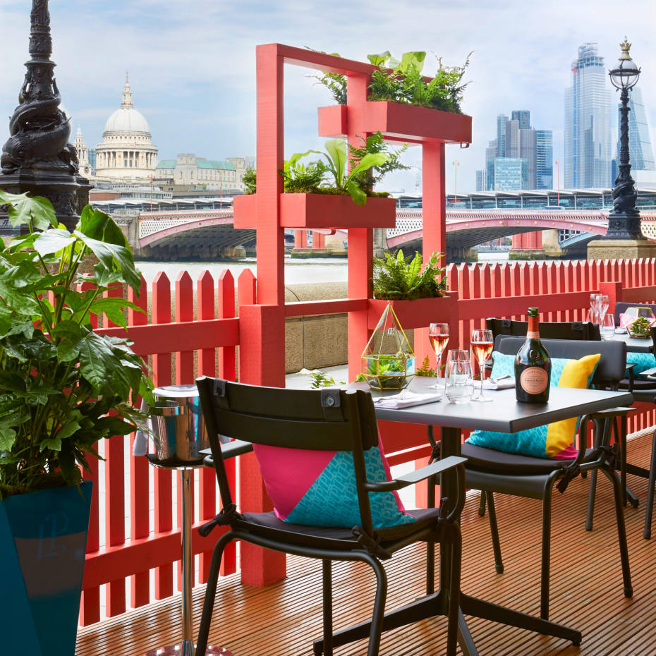 The Laurent-Perrier champagne terrace at Sea Containers restaurant offers striking views over the river towards St Paul's