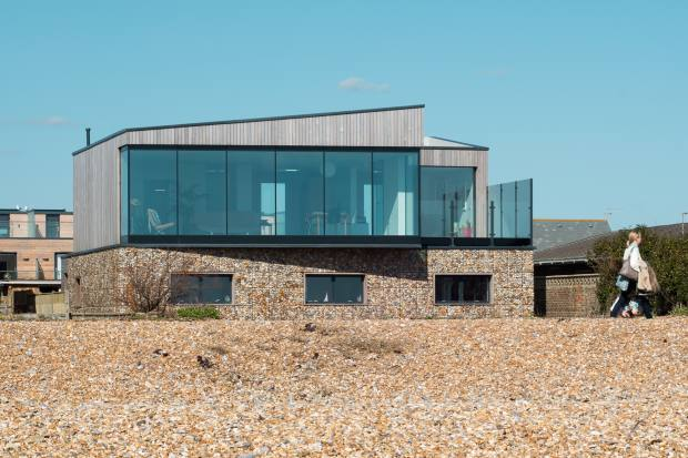 ABIR Architects designed this home in Shoreham-by-Sea with all the living spaces on the top floor