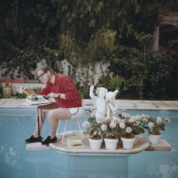 Comedian Stan Freberg working in his swimming pool in 1962