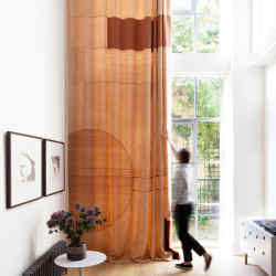 The voile curtain created by Nest Design for aShoreditchwarehouse with 6m-high ceilings