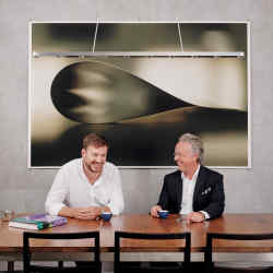 Barth Johnson (left) and Lionel Aeschlimann with Paper Drop(Dark), 2006, by Wolfgang Tillmans, and Chaos+ Repair = Universe, 2014, by Kader Attia