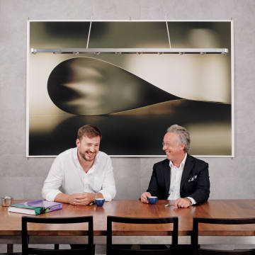 Barth Johnson (left) and Lionel Aeschlimann with Paper Drop (Dark), 2006, by Wolfgang Tillmans, and Chaos + Repair = Universe, 2014, by Kader Attia