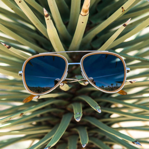 Vuarnet Pilot aviators in amber with blue polar lenses, $380, from the Edge Collection