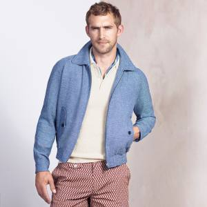 Dunhill wool/silk/linen blouson, £970, silk polo shirt, £675, and cotton swim shorts, £275