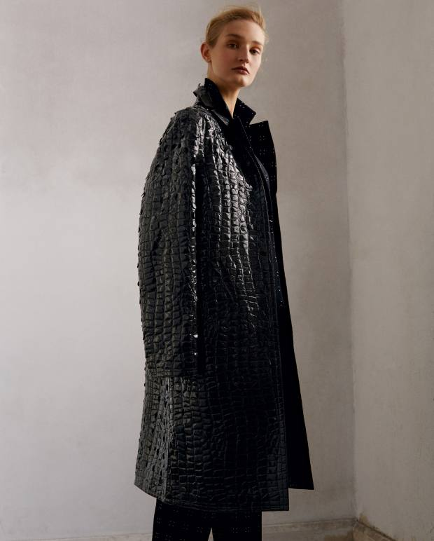 Nina Ricci embossed polyurethane coat, about £2,600.  Emporio Armani wool jacket, £690, and matching trousers, £560