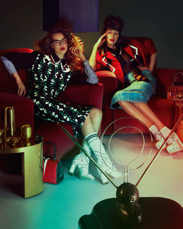 From left: Josefien wears Miu Miu silk-mix and leather dress, £2,110, cotton shirt, £385, cotton socks, £45, and leather boots, £1,395. Anna‑Karin Karlsson glasses, £365. Prada calfskin bag (on floor), £1,985. Alexandra wears Miu Miu leather jacket, £3,215, nylon shirt, £635, wool-mix skirt, £725, leather shoes, £925, Plexi tiara, £240, fox fur and Plexi charm, £290, and python bag (on table), £1,815. Topshop glitter socks, £3.50 