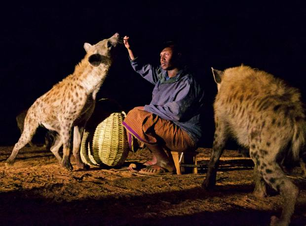 "Abbas, son of ""hyena man"" Youssef Mume Saleh, who feeds the hyenas in the city of Harar"