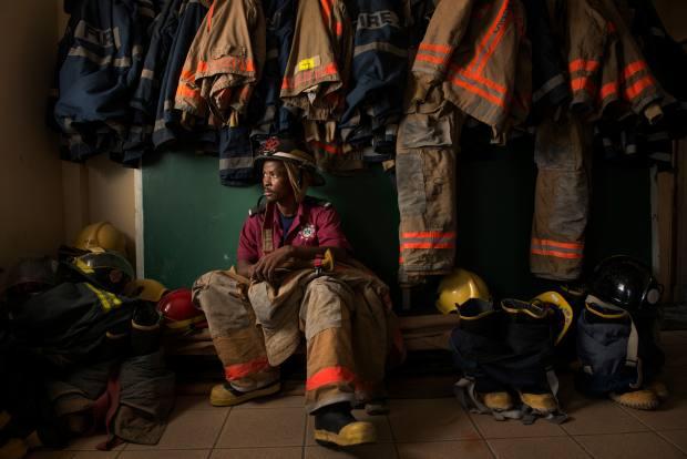 A fireman in St Lucia's Soufrière fishing port
