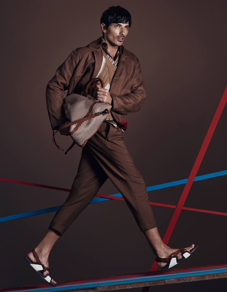 Cerruti linen car coat, about £916, and wool/mohair trousers, about £388. Prada cashmere jumper, £2,535, cotton-poplin shirt, £445, and calfskin sandals, £595. Jimmy Choo woven-linen and leather bag, £1,795Antique floorboards seen throughout, from Lassco Ropewalk