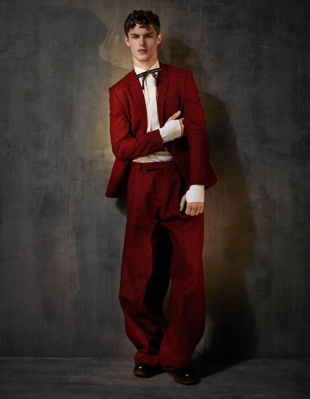 Dior Homme wool jacket, £1,500, matching trousers, £910, cotton poplin shirt, £410, calfskin and rubber Chelsea boots, £630, and silk faille bow tie, £100