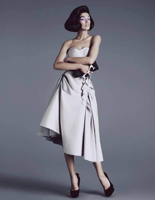 Duchesse satin bustier dress, £3,490, by Lanvin. Suede shoes, £700, by Bottega Veneta. Curly lambskin Cayla clutch bag, £2,295, by Jimmy Choo. Sunglasses, £180, by Miu Miu