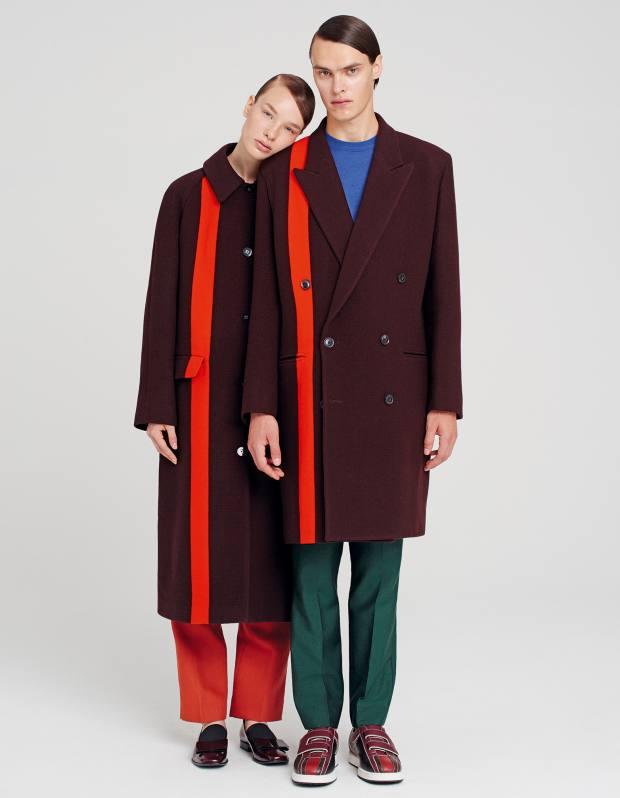 She wears Paul Smith wool coat, £905, wool/silk trousers, £305, and leather loafers, £375. He wears Paul Smith wool coat, £1,305, merino wool/silk jumper, £230, and wool/mohair trousers, £300. Bottega Veneta calfskin shoes, £480