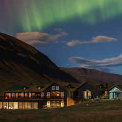 Spectacular Northern Lights above the remote Deplar retreat in northern Iceland