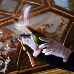 The sabrage ceremony upholds the custom of using a sword to uncork a champagne bottle