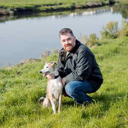 Nathan Outlaw and his dog Bud walk along the Camel Estuary