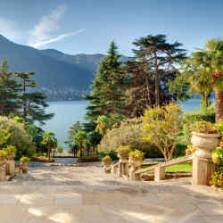 Stairways lead down through Villa Passalacqua's ornate gardens to Lake Como