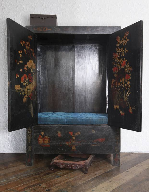 This 18th-century Chinese lacquered reading cabinet, £12,000, was finished in burnished graphite over handmade gesso, with a period velvet fragment cushion made by Debbie Pexton.