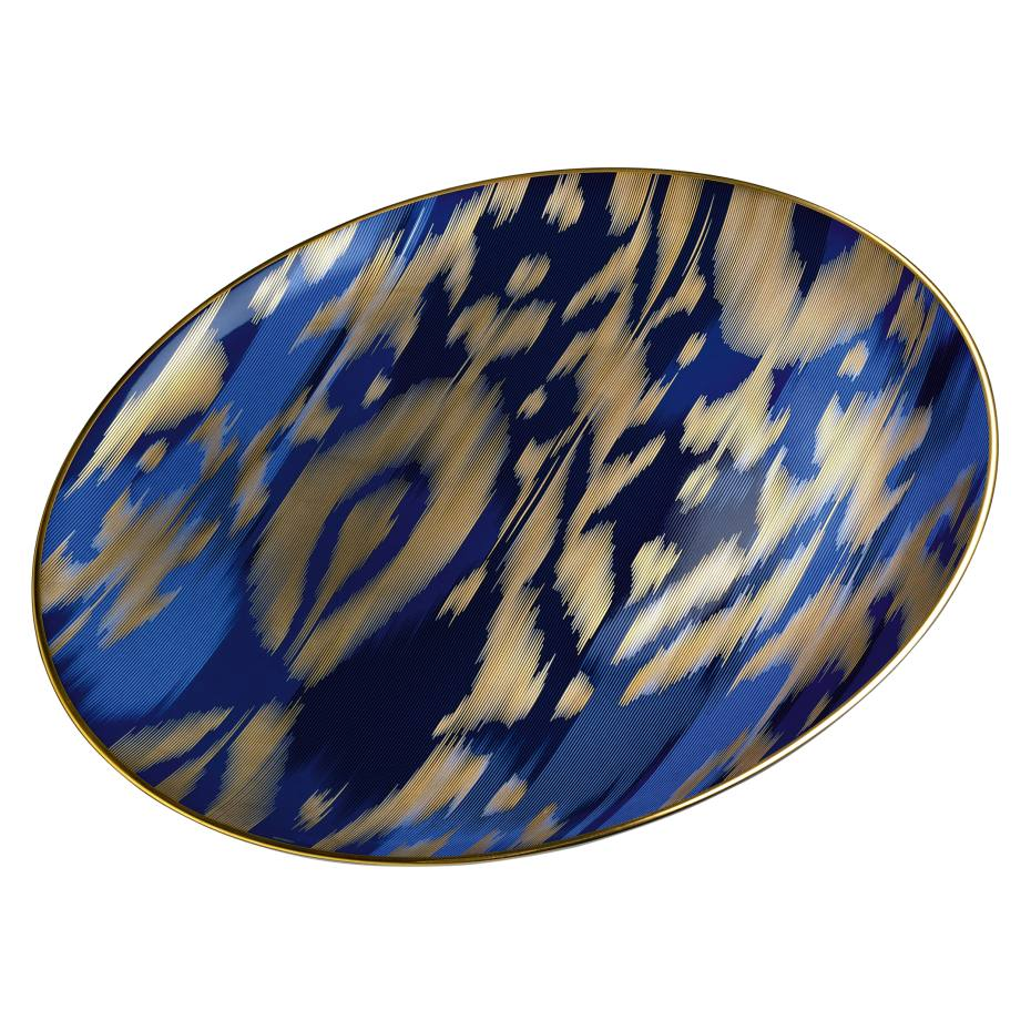 Hermès Voyage en Ikat presentation plate (33.5cm diameter) in porcelain and matte 24ct gold paint, £352. Also in other colours