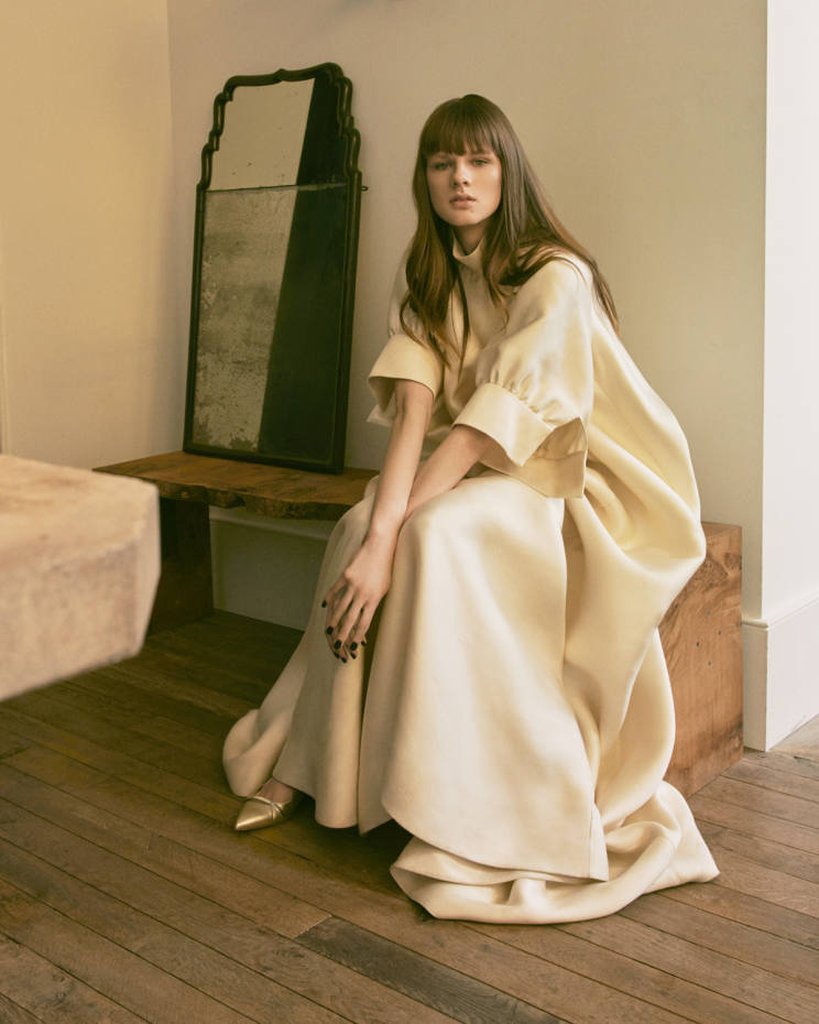 The Row silk-mikado dress, £5,400. Malone Souliers nappa leather Maureen pumps, £445. Early-18th-century walnut mirror, now sold, and pippy-oak bench, £2,112, both from Rose Uniacke