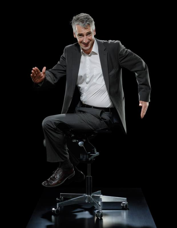 Corporate training CEO Andy Habermacher tries out the chair
