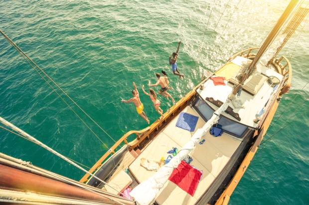 Pleasure seekers diving off a gulet in Turkey
