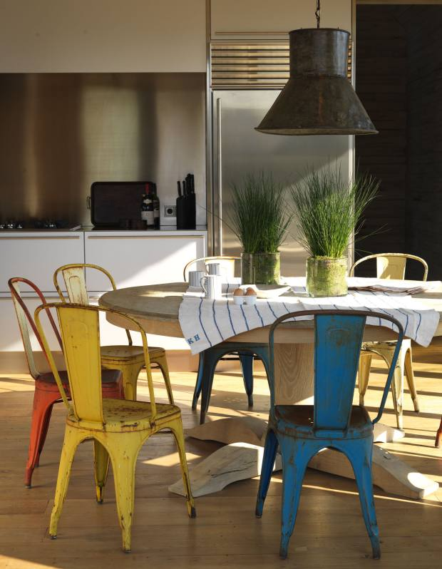The kitchen of the Lake House is furnished with 20th-century metal industrial chairs.